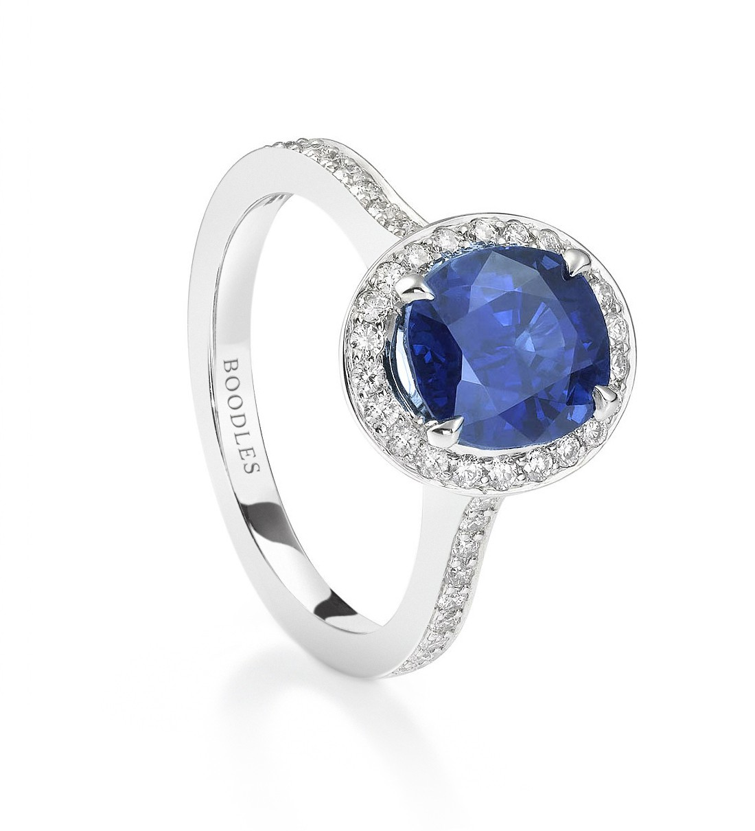 a gorgeous vintage blue sapphire engagement ring oval